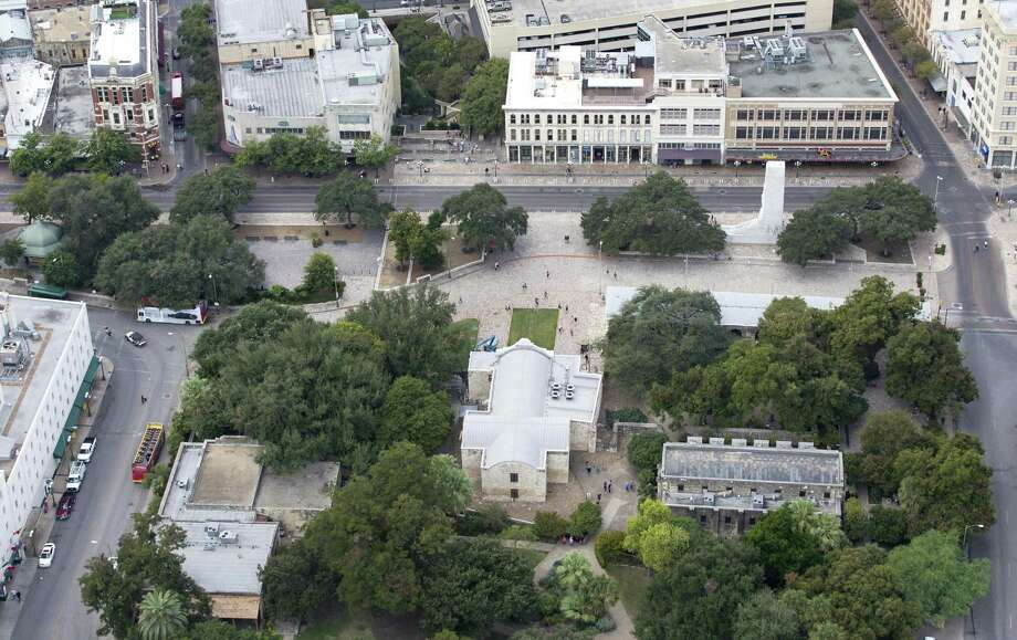 Alamo Plaza, with the Alamo bottom center of the image, is seen in a Thursday Oct. 8, 2015 aerial photo. Three buildings the Texas General Land Office recently agreed to buy are seen in the upper right side of the frame just behind the white marble cenotaph. A small portion of the Menger hotel can be seen on the lower left part of the image. Photo: WILLIAM LUTHER, Staff / San Antonio Express-News / © 2015 San Antonio Express-News