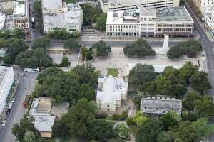 Alamo Plaza, with the Alamo bottom center of the image, is seen in a Thursday Oct. 8, 2015 aerial photo. Three buildings the Texas General Land Office recently agreed to buy are seen in the upper right side of the frame just behind the white marble cenotaph. A small portion of the Menger hotel can be seen on the lower left part of the image.