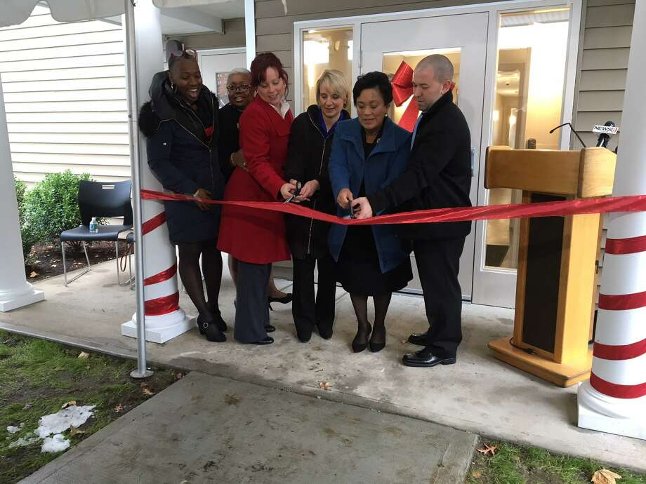From left, State Rep. Robyn Porter, Alder Delphine Clyburn, Kathy Grega, Evonne Klein, Mayor Toni Harp and Tim Maguire at new supportive youth housing on Winchester Avenue. Photo: By Mary O'Leary /