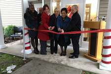 From left, State Rep. Robyn Porter, Alder Delphine Clyburn, Kathy Grega, Evonne Klein, Mayor Toni Harp and Tim Maguire at new supportive youth housing on Winchester Avenue.