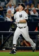 New York Yankees designated hitter Chase Headley gestures nearing home plate after hitting a fourth-inning, two-run, home run off Baltimore Orioles Vance Worley in a baseball game in New York, Friday, Aug. 26, 2016. (AP Photo/Kathy Willens)