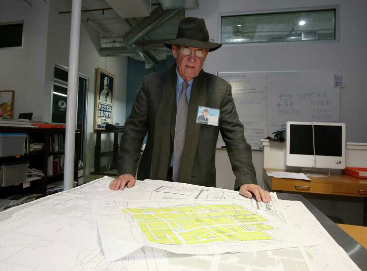"""11/20/12: 11/20/12: Pete Brown with Houston street maps in his office in Houston, Texas.  After very seriously running in 2009, architect and former city council member Peter Brown has transformed himself into Houston's leading utopian. His group, Better Houston, promotes urban planning and walkability. In on-line videos, Brown turns himself into a Stephen Colbert-like character, """"Pedestrian Pete,"""" who walks around the city with guests, chatting about the good, the bad and the ugly."""