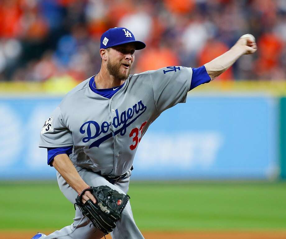 Los Angeles Dodgers relief pitcher Tony Watson (33) pitches during the eighth inning of Game 4 of the World Series at Minute Maid Park on Saturday, Oct. 28, 2017, in Houston. ( Brett Coomer / Houston Chronicle ) Photo: Brett Coomer, Houston Chronicle