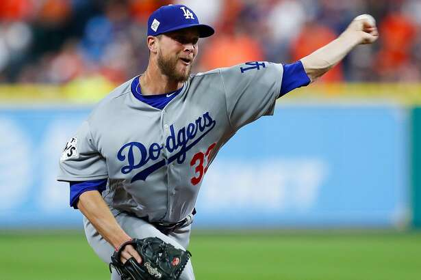 Los Angeles Dodgers relief pitcher Tony Watson (33) pitches during the eighth inning of Game 4 of the World Series at Minute Maid Park on Saturday, Oct. 28, 2017, in Houston. ( Brett Coomer / Houston Chronicle )