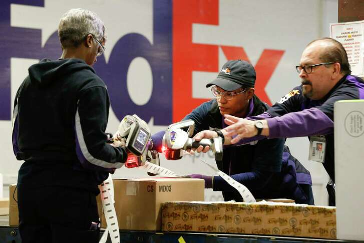 Packages are scanned as they travel down a conveyor belt in the FedEX's Holly Hall facility  Tuesday, Dec. 12, 2017, in Houston. FedEx expects to ship 380 million to 400 million packages this holiday season. The Holly Hall facility in Houston is a critical part of the overall operation for the Houston area, and it's plugged into the company's global shipping network.  ( Steve Gonzales / Houston Chronicle )