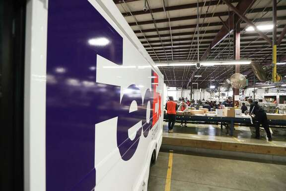 Packages flow down a conveyor belt in the FedEX's Holly Hall facility  Tuesday, Dec. 12, 2017, in Houston. FedEx expects to ship 380 million to 400 million packages this holiday season. The Holly Hall facility in Houston is a critical part of the overall operation for the Houston area, and it's plugged into the company's global shipping network.  ( Steve Gonzales / Houston Chronicle )