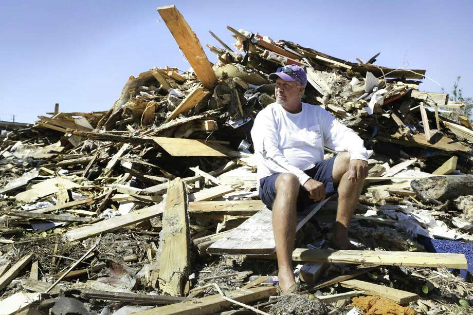 Gray Gant, 51, , sits on the rubble in 2017 that was his house before Hurricane Harvey hit Port Aransas. A report makes recommendation to prepare for the next disaster. Photo: Bob Owen /Staff File Photo / ©2017 San Antonio Express-News