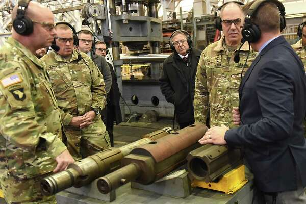 Gustave (Gus) Perna, second from right, a United States Army four-star general who serves as Commander of the United States Army Materiel Command, talks to John Zayhowski, chief of manufacturing at the arsenal, as he visits the Watervliet Arsenal on Monday, Dec. 11, 2017 in Watervliet, N.Y. (Lori Van Buren / Times Union)
