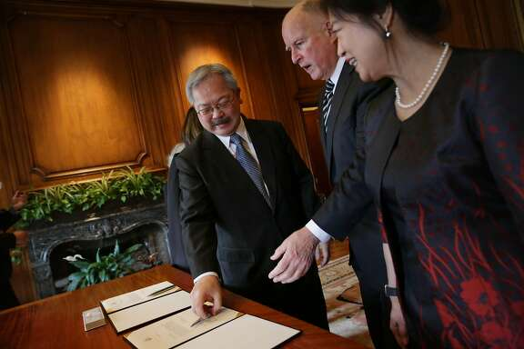 Mayor Ed Lee (l to r), Governor Jerry Brown and Anita Lee talk after Lee and Brown sign the Oath of Office as before Lee's Inauguration at City Hall on Friday, January 8, 2015 in San Francisco, Calif.