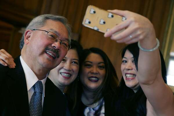 Mayor Ed Lee (l to r) takes a selfie with his wife Anita Lee, daughter Tania Lee and daughter Brianna Lee in his office at City Hall before his Inauguration on Friday, January 8, 2015 in San Francisco, Calif.