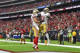 HOUSTON, TX - DECEMBER 10: San Francisco 49ers wide receiver Marquise Goodwin (11) and tight end Garrett Celek (88) celebrate Celek's touchdown reception during the football game between the San Francisco 49ers and the Houston Texans on December 10, 2017 at NRG Stadium in Houston, Texas. (Photo by Daniel Dunn/Icon Sportswire via Getty Images)