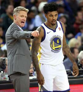 Golden State Warriors' head coach Steve Kerr instructs Nick Young in 2nd quarter against Orlando Magic during NBA game at Oracle Arena in Oakland, Calif., on Monday, November 13, 2017.