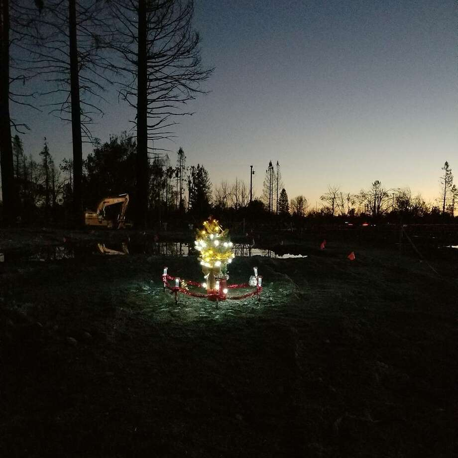 Samantha Eggert put up a tree where her home in Coffey Park used to be. Photo: Samantha Eggert