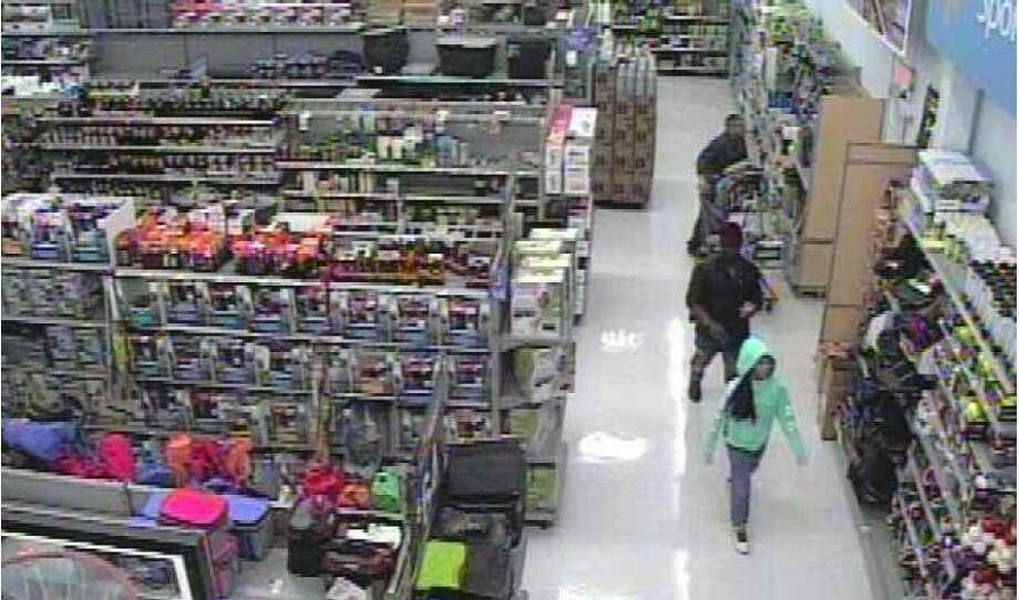 Police are hoping to find the identities of this girl in the hooded sweatshirt and the man behind her in a child groping and luring case at the Renton Walmart. Officers spotted this girl while reviewing footage for other accusations and hope to ensure she is safe. Photo: Courtesy Renton Police Department