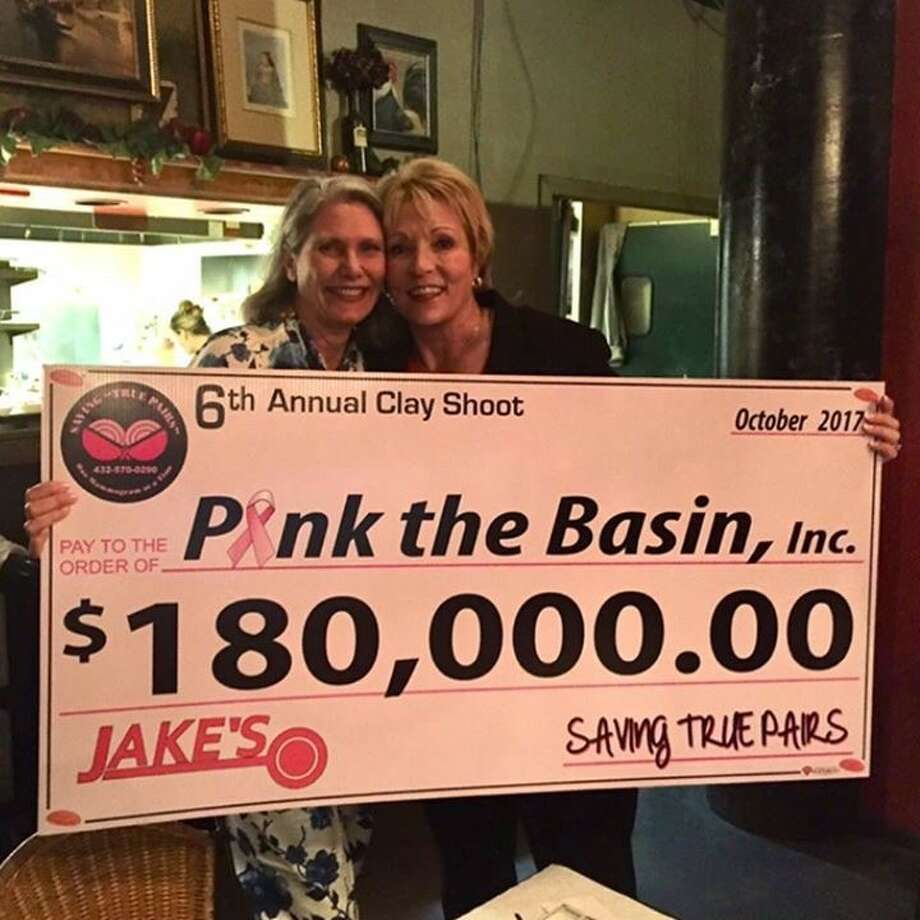 Pink The Basin accepts donation from Saving True Pairs Clay Shoot. Photo: Courtesy Photo
