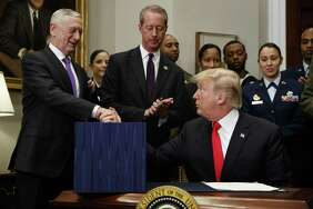 President Donald Trump shakes hands with Secretary of Defense Jim Mattis after signing the National Defense Authorization Act for Fiscal Year 2018, in the Roosevelt Room of the White House, Tuesday, Dec. 12, 2017, in Washington. (AP Photo/Evan Vucci)