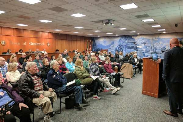 On Tuesday afternoon a crowd gathered at Greenwich Town Hall to hear state representatives speak against proposed cuts to health coverage in Connecticut.