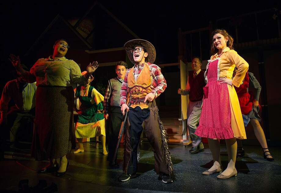 Ralphie (Jonah Broscow, center) fantasizes about coming to the rescue with his Red Ryder BB gun. Photo: Jessica Palopoli, San Francisco Playhouse