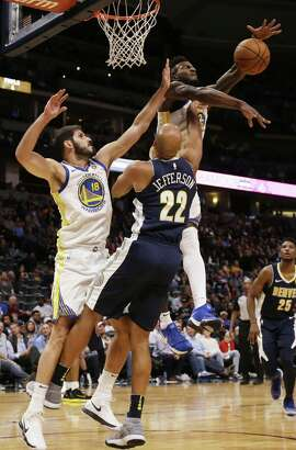 Golden State Warriors forward Jordan Bell (2) and forward Omri Casspi (18) block a shot by Denver Nuggets forward Richard Jefferson (22) during the fourth quarter of an NBA basketball game Saturday, Nov. 4, 2017, in Denver. (Photo by Jack Dempsey)