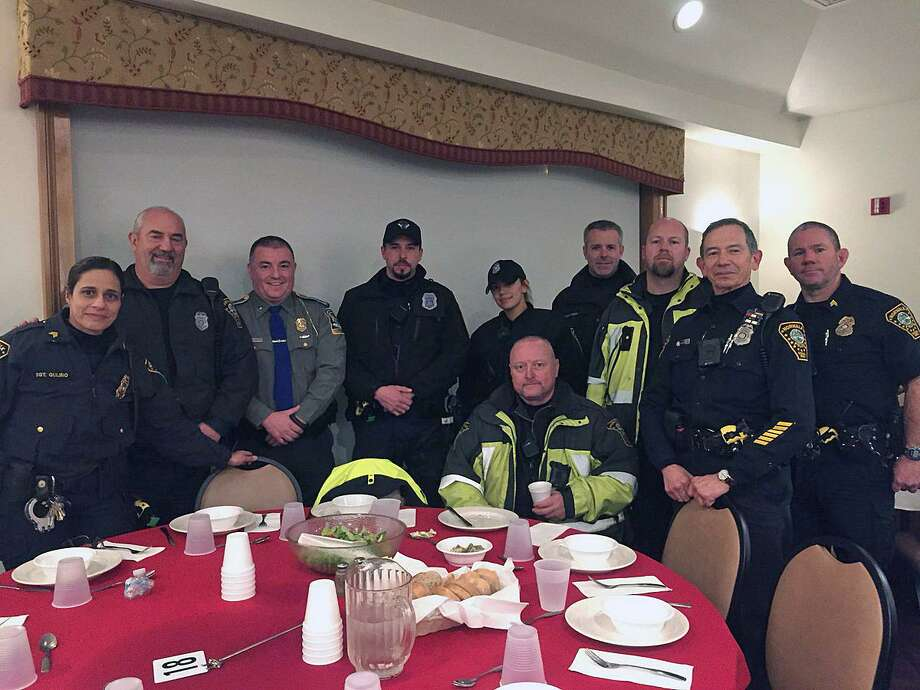 Norwalk, Conn., police met the Wreaths Across America convoy as it entered the town around 6 p.m. on Tuesday, Dec. 12, 2017. They were settled in to eat at St. Ann's Club shortly after arriving. Photo: Contributed Photo / Norwalk Police Department / Contributed Photo / Connecticut Post Contributed