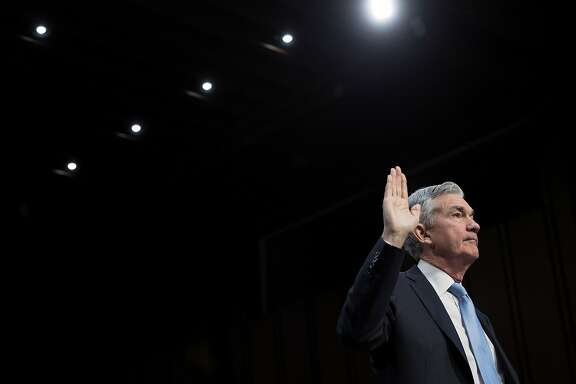 FILE - Jerome Powell is sworn in for his Senate confirmation hearing to become the Federal Reserve chairman, in Washington, Nov. 28, 2017. The Federal Reserve is expected to end the year by raising its benchmark interest rate for just the fifth time since the financial crisis. (Tom Brenner/The New York Times)