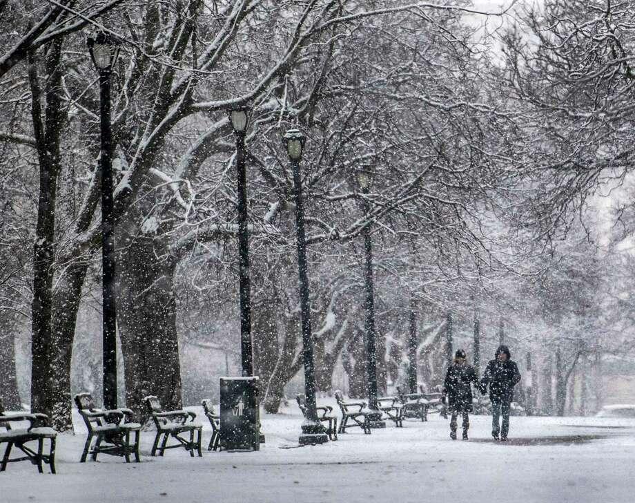 Tammy, left and Thomas Faist take a walk in Washington Park enjoying the snow Tuesday Dec 11, 2017 in Albany, N.Y.   (Skip Dickstein/ Times Union) Photo: SKIP DICKSTEIN