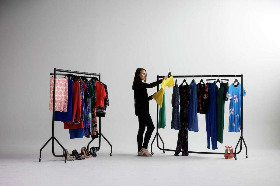 A model poses for a photo at Amazon.com's fashion photography studio in London. Searching for generic product categories on Amazon turns up plenty of private-label options. Photo: Simon Dawson / © 2015 Bloomberg Finance LP.