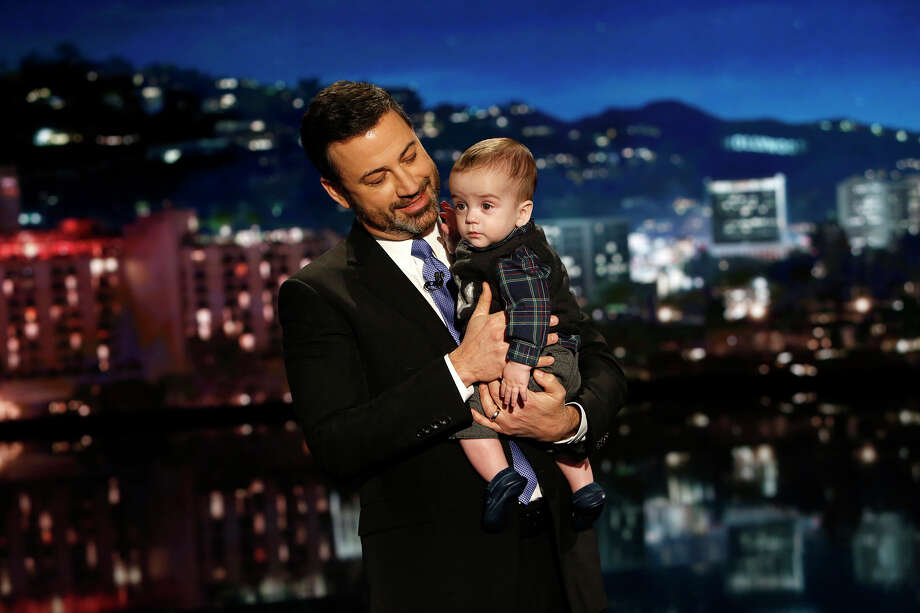 "This Dec. 11, 2017 image released by ABC shows host Jimmy Kimmel with his son Billy on ""Jimmy Kimmel Live!"" Kimmel held his baby son as he returned to his late-night show after a week off for the boy's heart surgery. Kimmel kept up his ardent advocacy Monday night, urging Congress to restore the Children's Health Insurance Program, which has been left unfunded and stuck in a political stalemate since September. (Randy Holmes/ABC via AP) ORG XMIT: NYET239 Photo: Randy Holmes / © 2017 American Broadcasting Companies, Inc. All rights reserved"