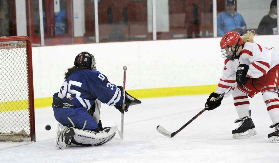 Greenwich's Riley Ellsworth shoots on Darien goalie Emily Gianunzio on Jan. 3. Photo: Bob Luckey Jr. / Hearst Connecticut Media / Greenwich Time