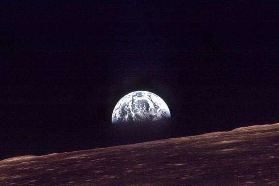 The earth rises over the horizon of the moon in this Dec. 24, 1968 file photo made by the astronauts on Apollo 8. (AP Photo/NASA)