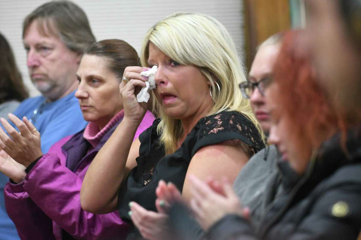 Brenda Morse, center, gets emotional after residents of Cohoes clap to show support for her husband Mayor Shawn Morse who leads a public meeting with the Cohoes Common Council at Cohoes City Hall on Tuesday, Dec. 12, 2017 in Cohoes, N.Y. (Lori Van Buren / Times Union)