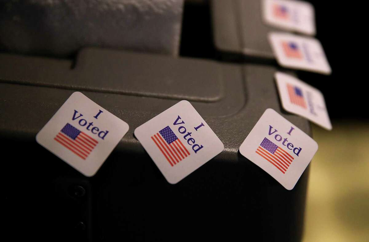"""In this file photo, """"I voted"""" stickers are displayed on a voting machine."""