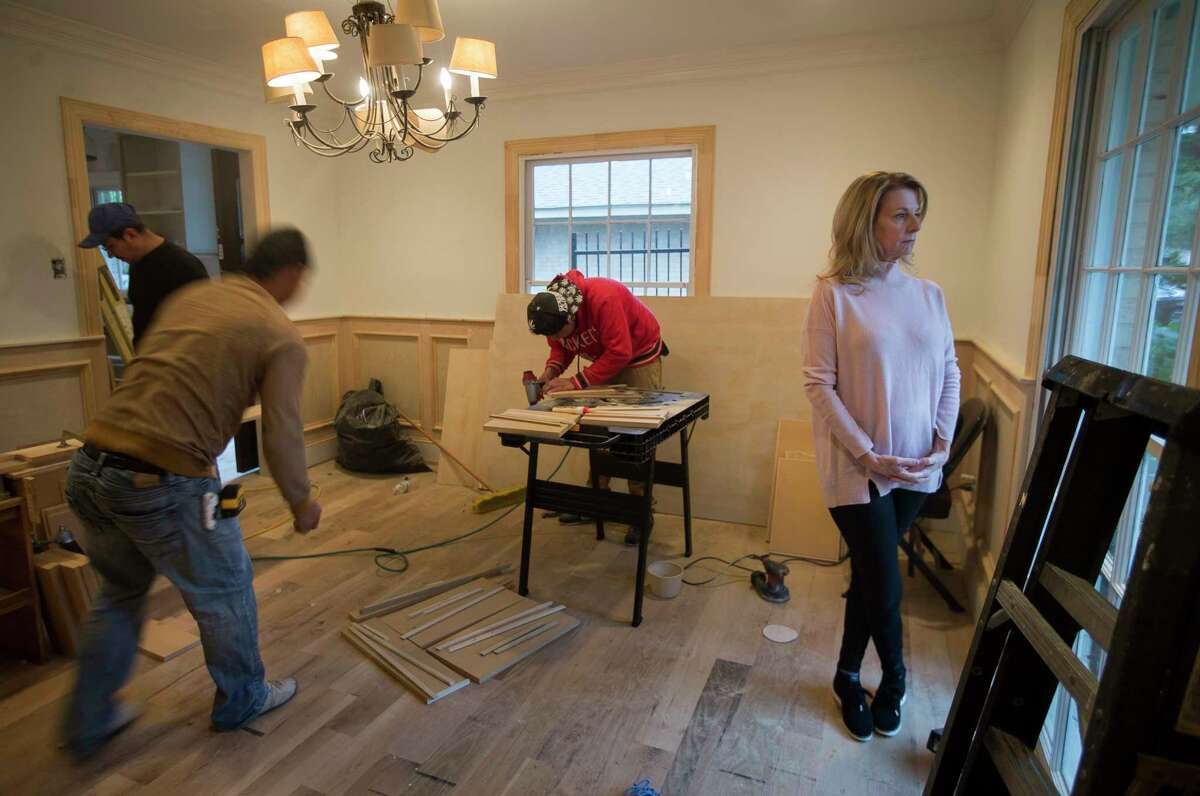 Valerie Caraway, whose house flooded during Harvey, has been paying out of pocket for many of the repairs to her home, Wednesday, Dec. 6, 2017, in Houston. Caraway has flood insurance and has received several checks, but the mortgage company servicing her loan has been slow to release the money. She is concerned about her finances going forward if she can't get the money to fund the improvements. In the meantime, she's living with a friend.( Mark Mulligan / Houston Chronicle )