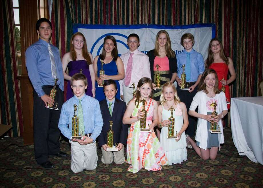 The winners of the Greenwich YWCA Dolphins Most Valuable Swimmers Award Bottom row from left: Aedan Lewis, Parker Scott, Alex Walsh, Kelly Montesi, Morgan Smith; Top row from left: Michael Dustin, Sarah McEvoy, Ellen Feeley, Andrew Stotesberry, Kitty Arenz, Thomas Dillinger, Caroline Scotti. Photo: Contributed Photo / Greenwich Citizen