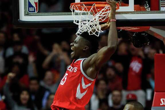 Rockets center Clint Capela gives LeBron James a close look at his bread-and-butter play, scoring on a dunk against the Cavaliers on Nov. 9.