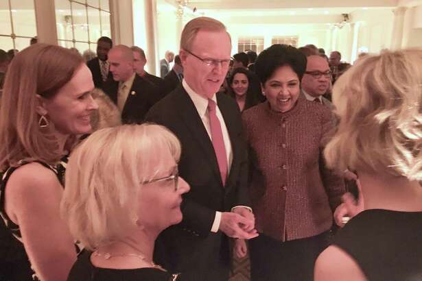 New York Giants owner John Mara talking with PepsiCo CEO Indra K. Nooyi at the Sandy Hook Promise benefit in New York. At foreground is Mara's wife, Denise.