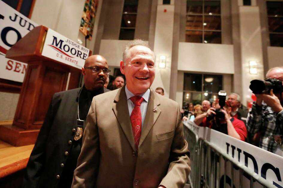 U.S. Senate candidate Roy Moore greets supporters during an election-night watch party at the RSA activity center, Tuesday, Dec. 12, 2017, in Montgomery, Ala.