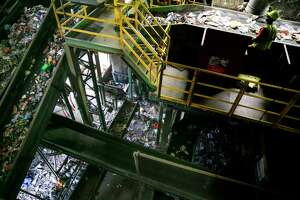 A Waste Management employee sorts through waste at the Gasmer Recycling Center Friday, June 2, 2017 in Houston. ( Michael Ciaglo / Houston Chronicle )