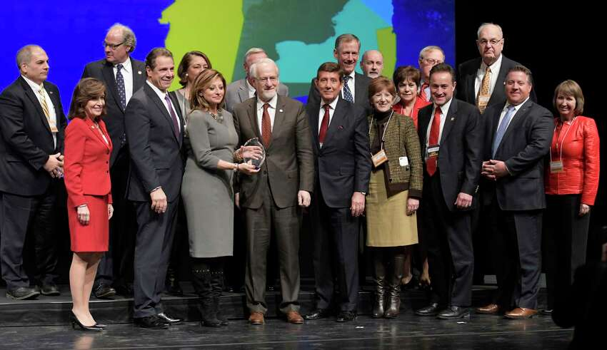 Governor Andrew Cuomo, second from left, stands with representatives of the Capital Region at the 2016 Regional Economic Development Council Awards on Thursday, Dec. 8, 2016, In Albany, N.Y. (Skip Dickstein/Times Union archive)