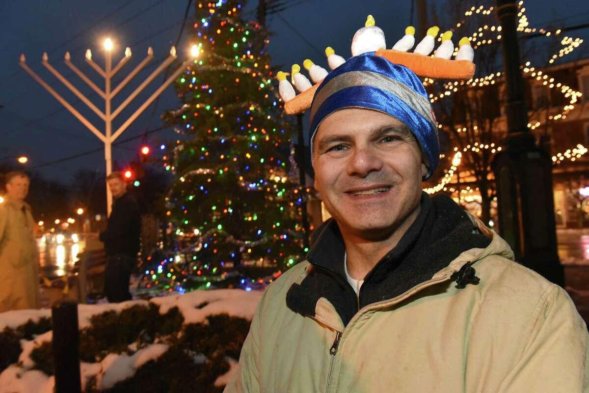 Robert Kasper of Delmar sports his menorah hat after members of the Bethlehem Chabad took part in a Hanukkah Menorah lighting at the Four Corners on Tuesday, Dec. 12, 2017, in Delmar, N.Y. (Lori Van Buren / Times Union)