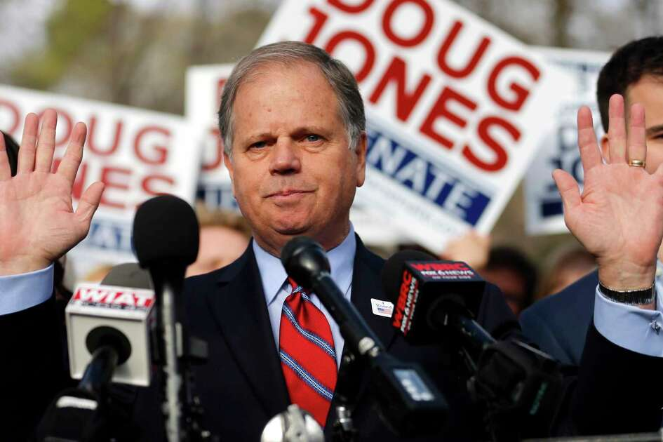 In this Tuesday, Dec. 12, 2017, photo, Democratic candidate for U.S. Senate Doug Jones speaks to reporters after voting in Mountain Brook, Ala. Jones won election to the U.S. Senate from Alabama, as voters in the deeply conservative and heavily Republican state deal a stark political blow to President Donald Trump and narrow the GOP's majority in the Senate to two.