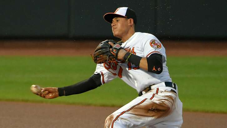 Baltimore Orioles third baseman Manny Machado throws from behind second base after snaring a grounder hit by the Texas Rangers' Shin-Soo Choo during the seventh inning at Oriole Park at Camden Yards in Baltimore on Wednesday, July 1, 2015. (Karl Merton Ferron/Baltimore Sun/TNS)