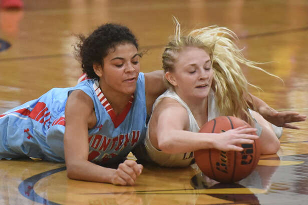 Midland High's Taysha Rushton (14) goes after a loose ball against Lubbock Monterey's Zan White (15) on Dec. 2, 2017, at Midland High. James Durbin/Reporter-Telegram