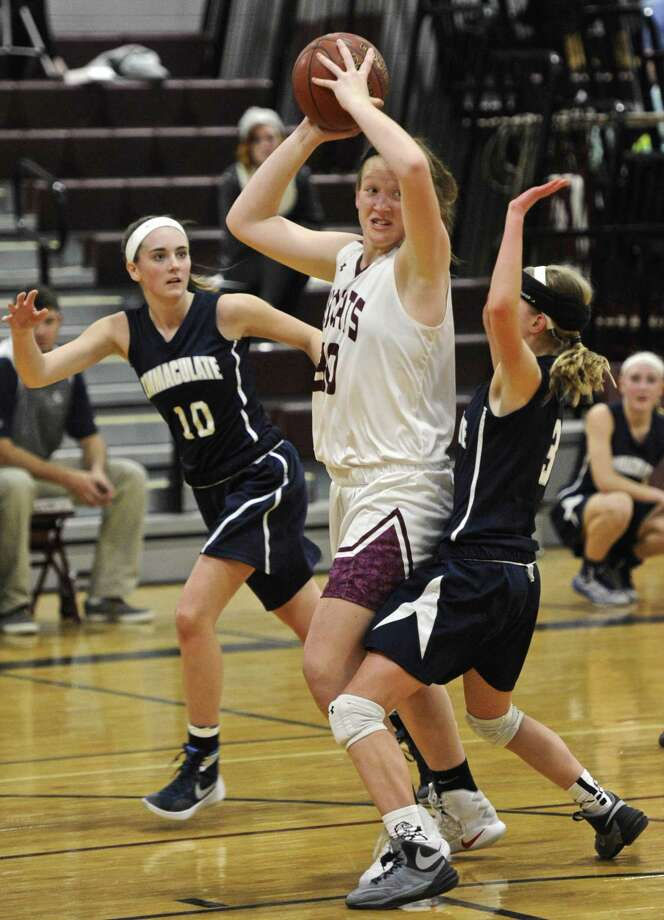 FILE PHOTO: Bethel's Maranda Nyborg (30) looks to pass the ball as she is boxed in by Immaculate's Megan Schlichtig (10) and Angela Saidman (3) in the girls SWC basketball game between Immaculate and Bethel high schools on Friday night, December 16, 2016, at Bethel High School, in Bethel, Conn. Photo: H John Voorhees III / Hearst Connecticut Media / The News-Times