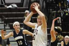 FILE PHOTO: Bethel's Maranda Nyborg (30) looks to pass the ball as she is boxed in by Immaculate's Megan Schlichtig (10) and Angela Saidman (3) in the girls SWC basketball game between Immaculate and Bethel high schools on Friday night, December 16, 2016, at Bethel High School, in Bethel, Conn.