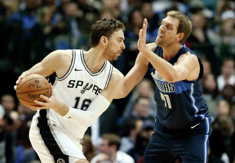San Antonio Spurs center Pau Gasol, left, of Spain looks for an opening to the basket against Dallas Mavericks' Dirk Nowitzki, right, of Germany in the first half of an NBA basketball game,Tuesday, Dec. 12, 2017, in Dallas. Photo: Tony Gutierrez, AP / Copyright 2017 The Associated Press. All rights reserved.