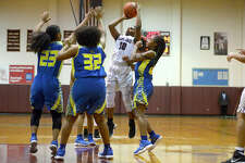 Central's Alexis Cooper takes a shot against Ozen in a girl's basketball game on Tuesday night.  Photo taken Tuesday 12/12/17 Ryan Pelham/The Enterprise