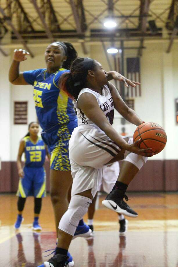Central's Alexis Cooper is fouled attempting a layup against Ozen in a girl's basketball game on Tuesday night.  Photo taken Tuesday 12/12/17 Ryan Pelham/The Enterprise Photo: Ryan Pelham / ©2017 The Beaumont Enterprise/Ryan Pelham