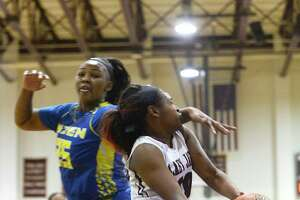 Central's Alexis Cooper is fouled attempting a layup against Ozen in a girl's basketball game on Tuesday night.  Photo taken Tuesday 12/12/17 Ryan Pelham/The Enterprise