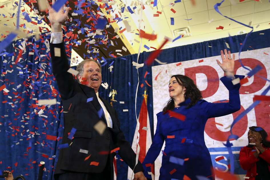 Democratic candidate for U.S. Senate Doug Jones and his wife Louise wave to supporters before speaking Tuesday, Dec. 12, 2017, in Birmingham, Ala. Jones has defeated Republican Roy Moore, a one-time GOP pariah who was embraced by the Republican Party and the president even after facing allegations of sexual impropriety.